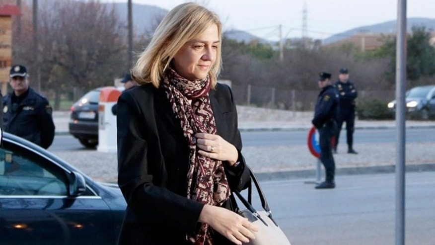 Spain's Princess Cristina arrives at a makeshift courtroom for a corruption trial, in Palma de Mallorca, Spain, Monday, Jan. 11, 2016.  Spain's Princess Cristina will make history as the first royal family member to face criminal charges since the monarchy was restored in 1975. She is accused of tax fraud related to a company she owned with her husband that allegedly helped fund the couple's lavish lifestyle. (AP Photo/Emilio Morenatti)