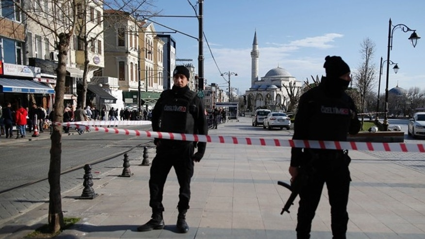 Policemen secure the historic Sultanahmet district after an explosion in Istanbul, Tuesday, Jan. 12, 2016. An explosion killed at least 10 people and wounded 15 others Tuesday morning in a historic district of Istanbul popular with tourists. Turkish President Recep Tayyip Erdogan said a Syria-linked suicide bomber is believed to be behind the attack. (AP Photo/Emrah Gurel)