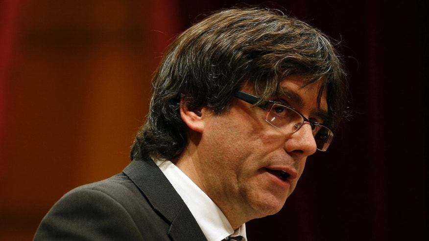 "Incoming Catalan President Carles Puigdemont speaks during the investiture session at the Catalonian parliament in Barcelona, Spain, Sunday, Jan. 10, 2016. Catalonia's pro-independence parties have agreed to appoint a new leader to enable the creation of a regional coalition government and reinvigorate a push for independence from Spain by 2017. Carles Puigdemont was selected Saturday to replace Artur Mas as the ""Together for Yes"" alliance's candidate for regional government leader. (AP Photo/Manu Fernandez)"