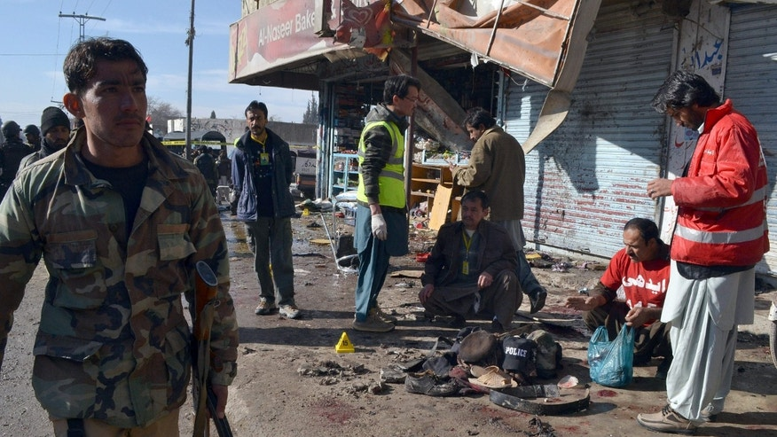 Jan. 13, 2016: Pakistani police officer and rescue workers gather at the site of suicide bombing in Quetta, Pakistan