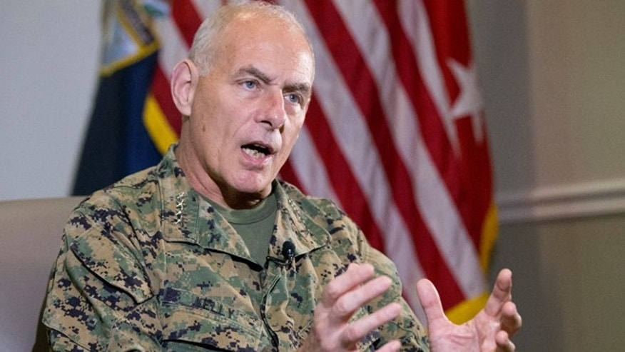 Marine Corps Gen. John F. Kelly, Commander of the U.S. Southern Command, gestures as he speaks during an interview with The Associated Press, Tuesday, Jan. 12, 2016, in Miami. Kelly says Cuba will attend an annual Caribbean security conference for the first time in another sign of normal relations between the long-hostile nations. The three-day event co-hosted by U.S. Southern Command will be this month in Jamaica. (AP Photo/Wilfredo Lee)