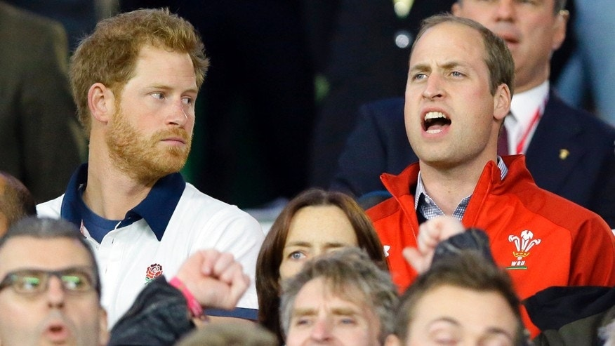 Sept. 26, 2015: Britain's Prince William, right, sings the national anthem of Wales as Prince Harry looks on ahead of the Rugby World Cup Pool A match between England and Wales at Twickenham Stadium, London.