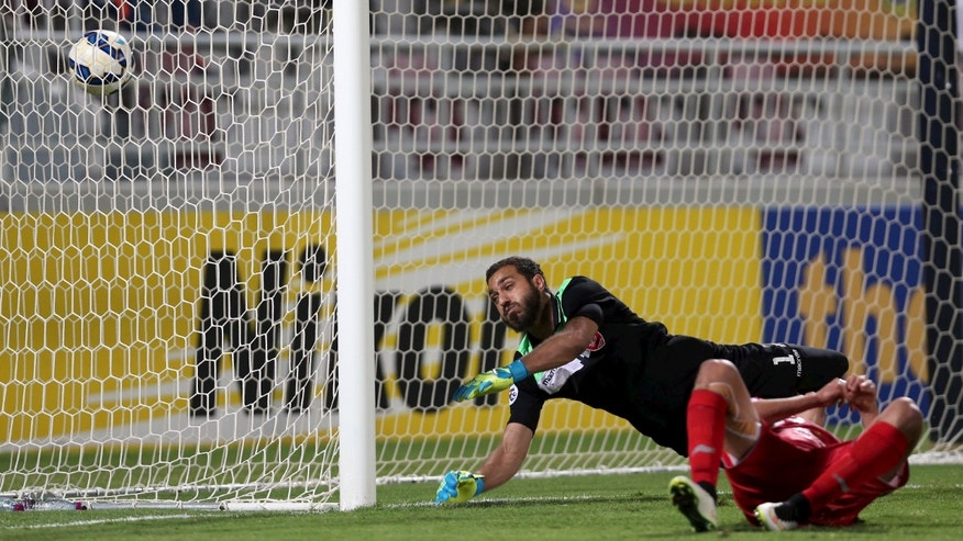 April 22, 2015: Youssef Msakni scores a goal against Sousha Makani during their AFC Champions League. (Reuters)