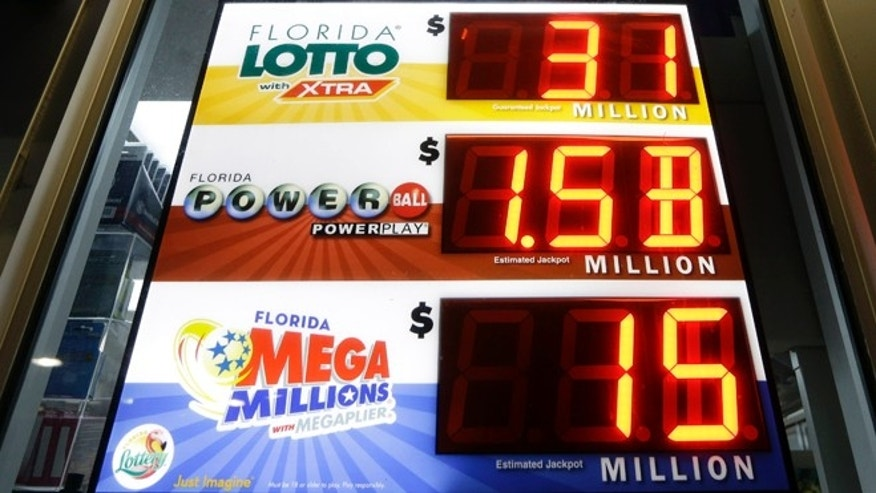 A sign shows the Powerball jackpot at a gas station Tuesday, Jan. 12, 2016, in Miami. The Powerball jackpot has grown to over $1 billion dollars for the next drawing on Wednesday. (AP Photo/Alan Diaz)