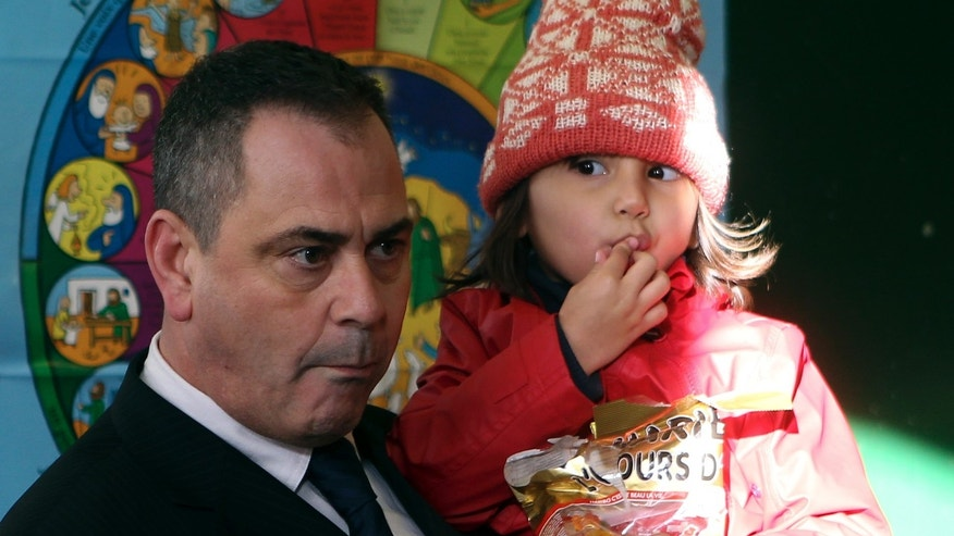 Rob Lawrie with 4-year-old Bahar Ahmadi in his arms.