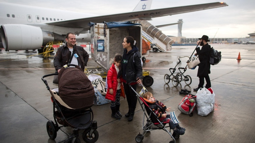 Dec. 22, 2014: Jewish immigrants from Ukraine arrive at the Ben-Gurion International Airport near Tel Aviv. (AP Photo/Oded Balilty)