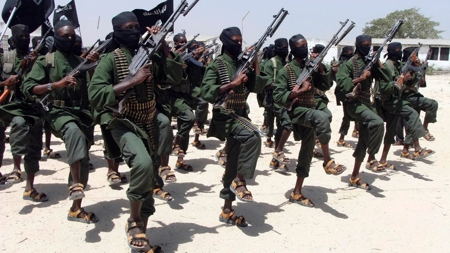 FILE - In this Thursday, Feb. 17, 2011 file photo, hundreds of newly trained al-Shabab fighters perform military exercises in the Lafofe area, some 18 kilometers (11 miles) south of Mogadishu, in Somalia.