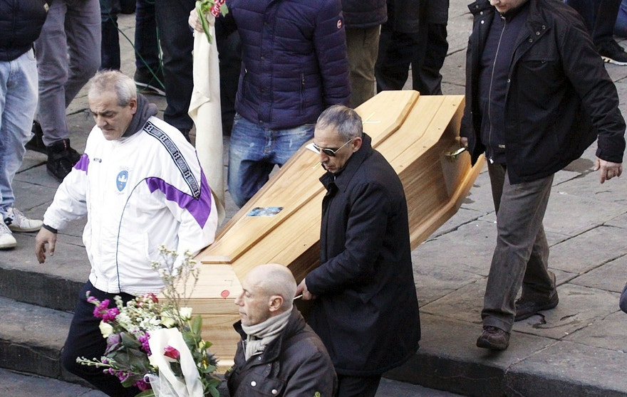 The wooden casket carrying the remains of Ashley Olsen, 35, is brought into the Santo Spirito basilica during her funeral service in Florence, Italy, Friday, Jan. 15, 2016. Prosecutors say she was killed by a Senegalese man, Cheik Tidiane Diaw, she met at a disco, after a night of cocaine-fueled sex followed by a fight. (AP Photo/Fabrizio Giovannozzi)