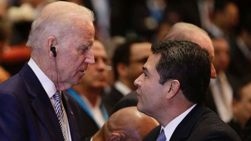 U.S. Vice President Joe Biden, center, talks with Honduras' President Juan Orlando Hernandez as Cuba's Vice President Salvador Valdes Mesa stands left, at the swearing-in ceremony for Guatemala's new President Jimmy Morales inside the National Theater in Guatemala City, Thursday, Jan. 14, 2016. The TV comic and political neophyte was inaugurated amid uncertainty over how he plans to run the Central American nation beset by entrenched poverty, corruption and violent criminal gangs. (AP Photo/Arnulfo Franco)