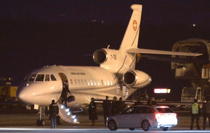 An unidentified man leaves a Dassault Falcon jet of Swiss army at the airport in Geneva, Switzerland, Sunday, Jan 17, 2016. A US government plane waited nearby to bring back to the US the men who were left from imprisonment in Iran the day before. (AP Photo/Laurent Cipriani)