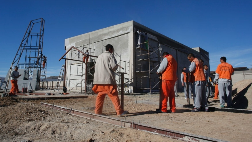 Inmates work construction inside the state prison in Ciudad Juarez, Sunday, Jan. 17, 2016.