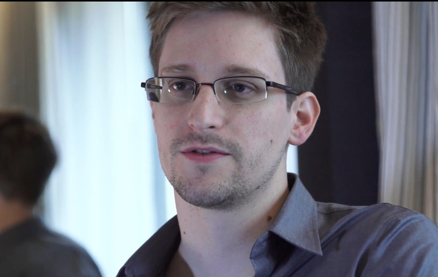 FILE - This Sunday, June 9, 2013 file photo provided by The Guardian Newspaper in London shows Edward Snowden, in Hong Kong. Russian state news agency said Wednesday, July 24, 2013 that US leaker Edward Snowden has been granted a document that allows him to leave the transit zone of a Moscow airport and enter Russia.  Snowden has applied for temporary asylum in Rusia last week after his attempts to leave the airport were thwarted. The United States wants him sent home to face prosecution for espionage.  (AP Photo/The Guardian, Glenn Greenwald and Laura Poitras, File)