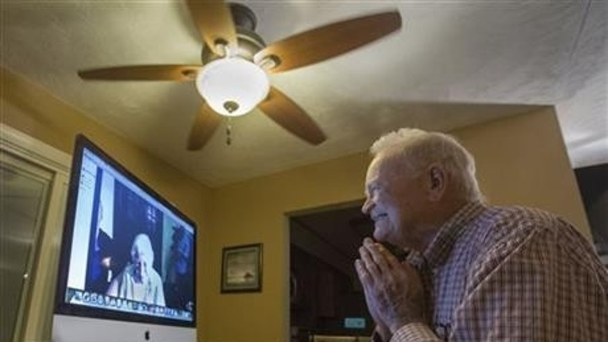 Nov. 6, 2015: Norwood Thomas, 93, talks with Joyce Morris via Skype from his home in Virginia Beach, Va. During World War II, Morris lived in England and was Joyce Durrant, the girlfriend of Thomas, a D-Day paratrooper with the Army's 101st Airborne Division. Morris now lives in Australia. (Bill Tiernan/The Virginian-Pilot via AP)