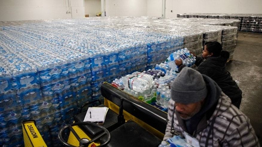 FLINT, MI - JANUARY 21:  Pallets of bottled water are seen ready for distribution in a warehouse January 21, 2016 in Flint, Michigan. The warehouse is the emergency water supply for Flint residents affected by lead-contaminated water.  (Photo by Sarah Rice/Getty Images)