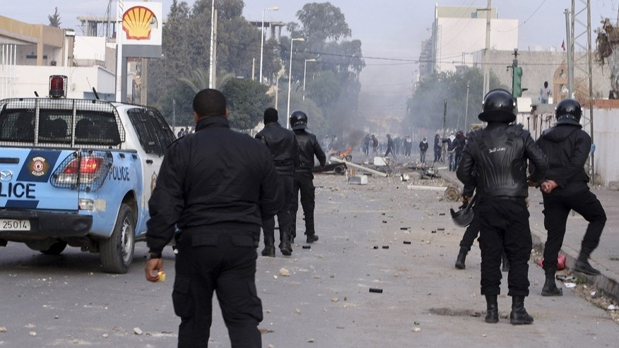 Jan. 20, 2016: Police forces face protesters in the city of Ennour, near Kasserine, Tunisia.