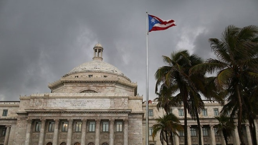 The Puerto Rican flag flies near the Capitol building. (Photo by Joe Raedle/Getty Images)