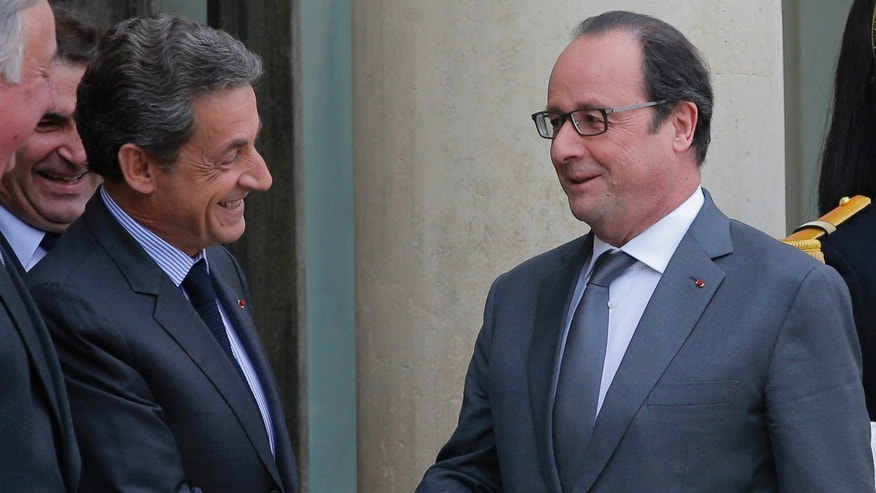"Jan. 22, 2016: French President Francois Hollande, right, shakes hands with Nicolas Sarkozy, former French President and head of the conservative ""Les Republicains"" party, after a meeting at the Elysee Palace, in Paris."