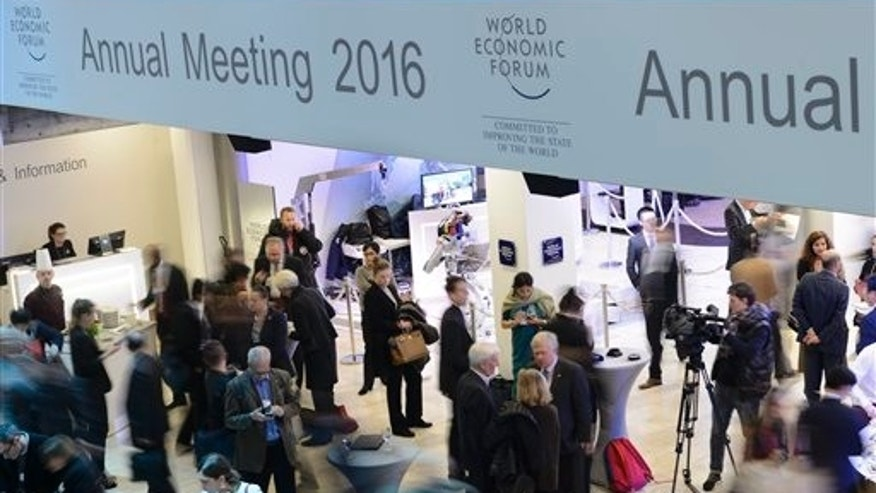 Participants queue for the buffet on the closing day at the   Annual Meeting of the World Economic Forum, WEF, in Davos, Switzerland, Saturday, Jan.  23, 2016.   (Laurent Gillieron/Keystone via AP)