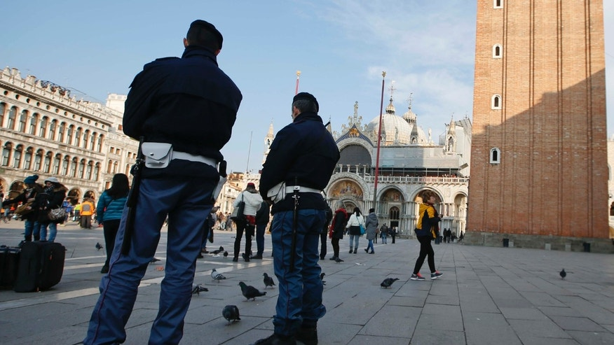 Jan. 23, 2016: Police officers patrol San Marco Square prior to the start of the Carnival Grand Opening show, in Venice, Italy.