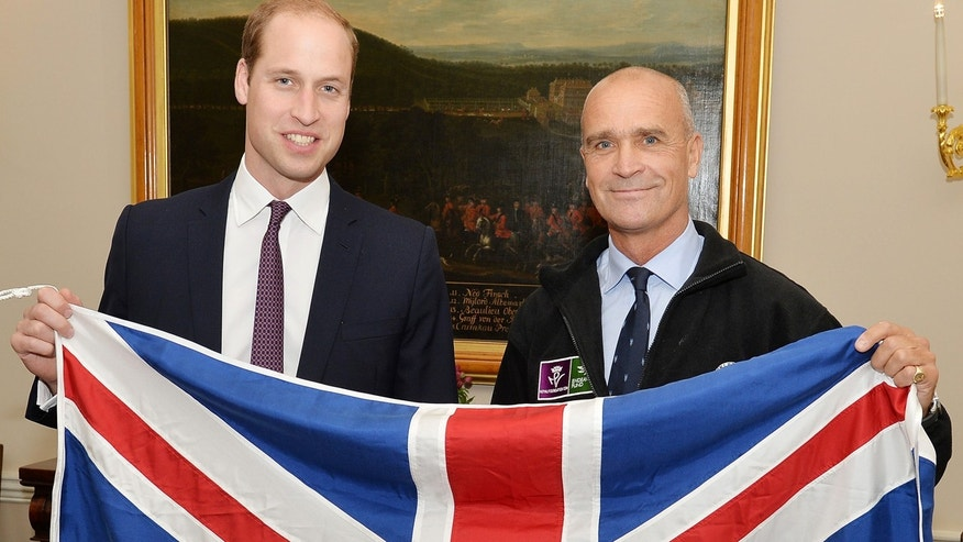 Oct. 19, 2015: Former British Army officer Henry Worsley, right, poses with Britain's Prince William as they hold the British flag in London. Worsley has died after suffering exhaustion and dehydration while attempting to cross the Antarctic alone, his family announced Monday.
