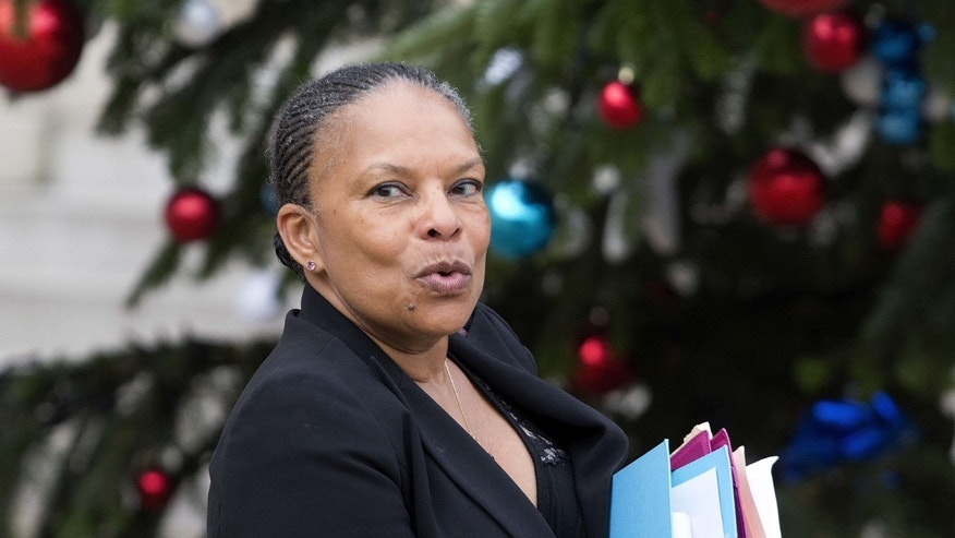 FILE - In this Jan.13, 2016 file photo, French Justice Minister Christiane Taubira walks out after the weekly cabinet meeting at the Elysee Palace, in Paris.