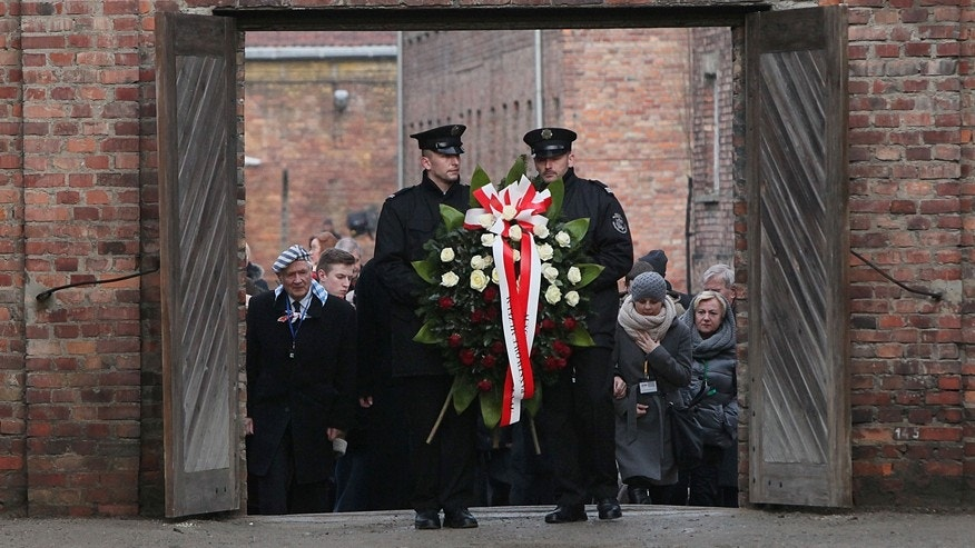 Jan. 27, 2016: Soldiers hold a wreath at the former Auschwitz Nazi death camp in Oswiecim, Poland.