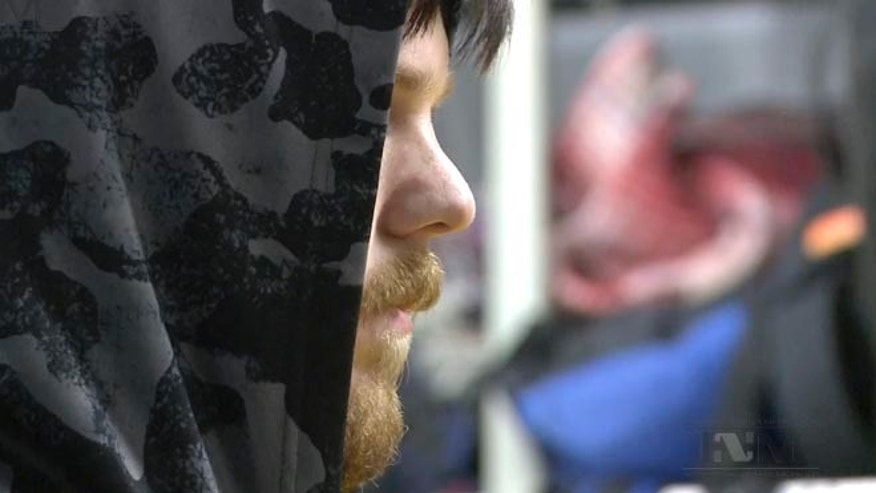"This frame grab from a Thursday, Jan. 28, 2016 taken from a video provided by Mexico's Instituto Nacional de Migracion, INM, shows a hooded Ethan Couch, as he is processed by Mexican immigration agents, in Mexico City. INM said that Couch, who used an ""affluenza"" defense in a 2013 fatal drunken-driving accident in Texas, was taken to the Mexico City airport from an immigration holding center, ending his month-long stay in Mexico.(Instituto Nacional de Migracion, INM via AP)"
