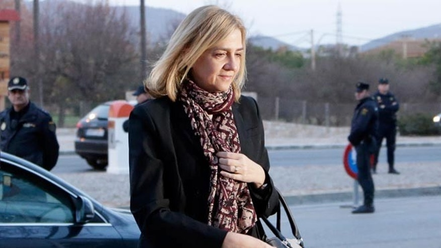 FILE - In this Monday, Jan. 11, 2016, file photo, Spain's Princess Cristina arrives at a makeshift courtroom for a corruption trial, in Palma de Mallorca, Spain. A court official says Spainâs Princess Cristina has lost her bid to avoid being tried for tax fraud in a corruption trial that also ensnared her husband and 16 others. The official says a panel of judges rejected Cristinaâs argument that she should not be tried because a prosecutor recommended she face at most administrative fines. (AP Photo/Emilio Morenatti, File)