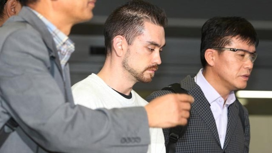 Sept. 23, 2015: Arthur Patterson, center, an American charged with murdering a Seoul university student in 1997, is escorted by South Korean police officers upon his arrival at Incheon International airport. (Im Hun-jung/Yonhap via AP)