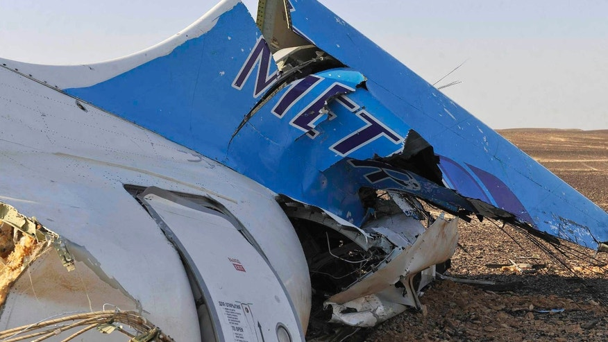 Oct. 31, 2015: This photo released by the Prime Minister's office shows the tail of a Metrojet plane that crashed in Hassana, Egypt.