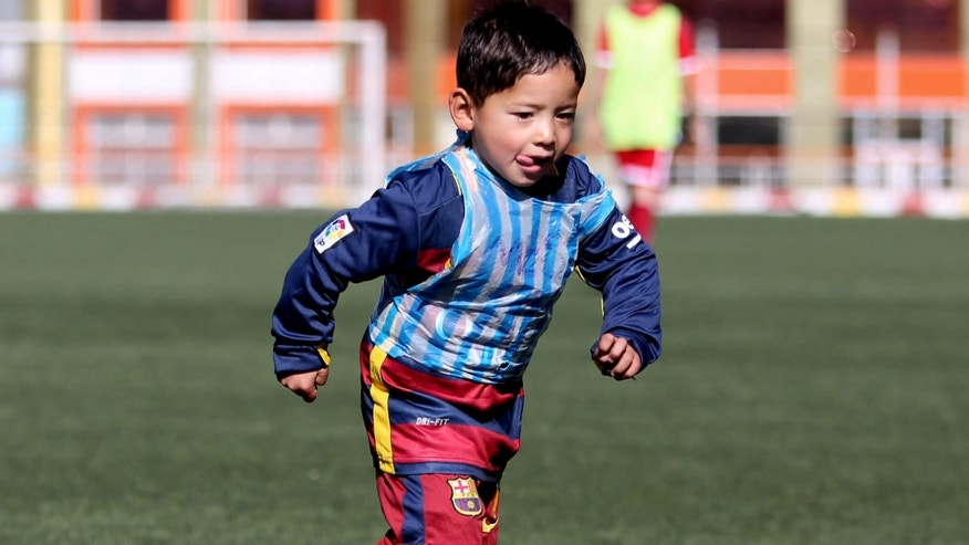 Feb. 2, 2015: Martaza Ahmadi, a five-year-old Afghan Lionel Messi fan, plays football at the Afghan Football Federation Stadium in Kabul, Afghanistan.
