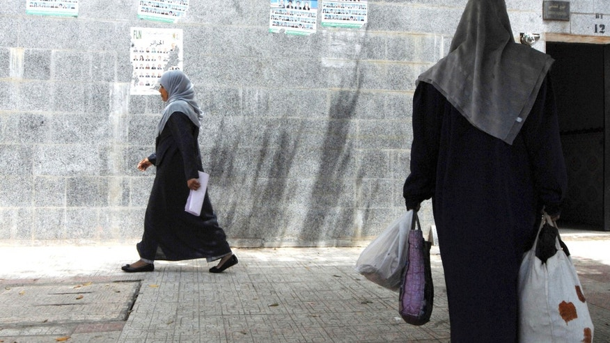 May 9, 2012: Women walk in Algiers. (AP)