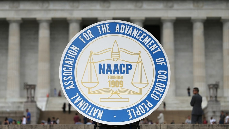"WASHINGTON, DC - JUNE 15:  A logo is seen for the National Association for the Advancement of Colored People as NAACP President and CEO Cornell William Brooks speaks during a press conference at the Lincoln Memorial June 15, 2015 in Washington, DC. Brooks announced ""America's Journey for Justice,"" an 860-mile march from Selma, Alabama to Washington, D.C. and a campaign ""to protect the right of every American to a fair criminal justice system, uncorrupted and unfettered access to the ballot box, sustainable jobs with a living wage, and equitable public education.""  (Photo by Win McNamee/Getty Images)"
