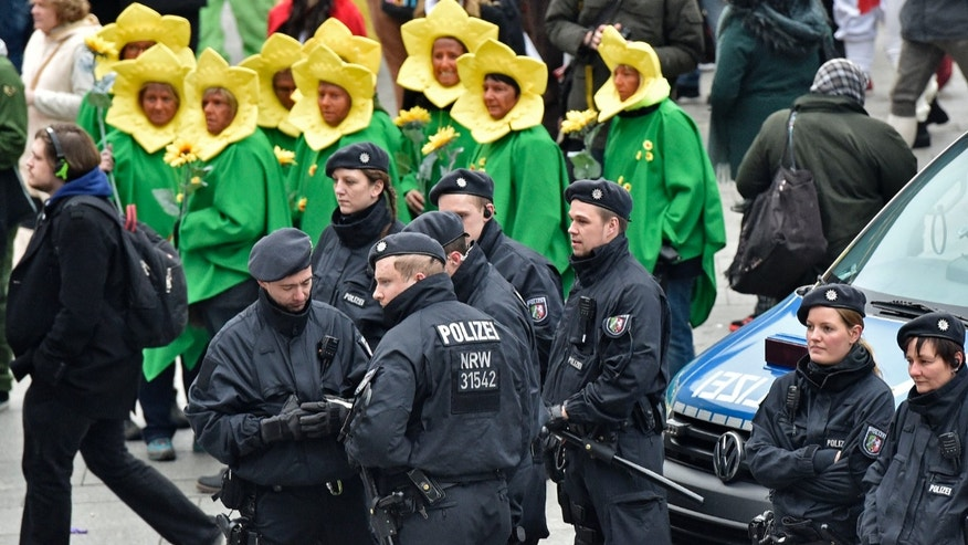 Police patrols in front of the main station during the start of the street carnival in Cologne, Germany on Thursday.