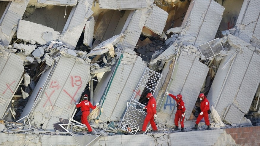 Feb. 7, 2016: Emergency rescuers continue to search for missing in a collapsed building from an earthquake in Tainan, Taiwan.