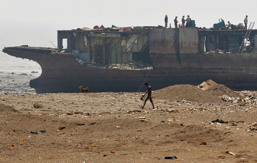 Workers dismantle a decommissioned ship at the Alang shipyard in the western Indian state of Gujarat, March 27, 2015. The European Union plans to impose strict new rules on how companies scrap old tankers and cruise liners, run aground and dismantled on beaches in South Asia. However the practice in India, Bangladesh and Pakistan, hazardous for humans and the environment, will still be hard to stop. European, Turkish and Chinese recyclers are set to benefit from the revamped standards. Depending on raw material prices, ship owners can make up to $500 per tonne of steel from an Indian yard, compared with $300 in China and just $150 in Europe.   REUTERS/Amit Dave