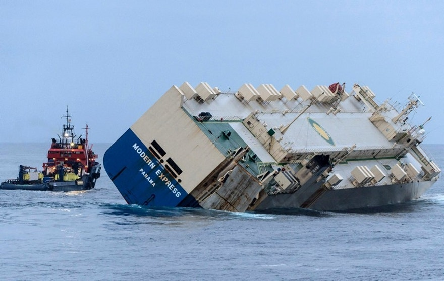 In this photo provided by the Prefecture Maritime Atlantique, the 164-meter (538-foot) cargo ship Modern Express is towed as it drifts off the coast of France Tuesday, Feb. 2, 2016. Rescuers successfully diverted the cargo ship threatening to run aground in southwestern France after five days adrift, and started towing it Tuesday toward the Spanish port of Bilbao. (Loic Bernardin/Prefecture Maritime Atlantique via AP)