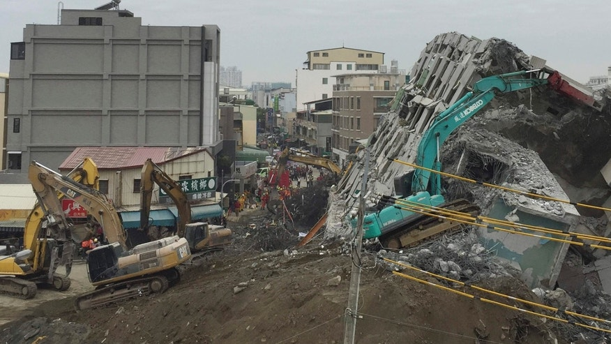Feb. 10, 2016: Rescue workers using excavators continue to search the rubble of a collapsed building complex in Tainan, Taiwan.