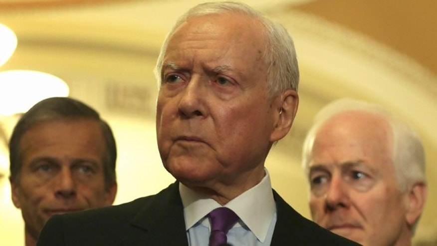 WASHINGTON, DC - MAY 12:  U.S. Sen. Orrin Hatch (R-UT) speaks to members of the media as (L-R) Sen. John Thune (R-SD), Senate Majority Whip Sen. John Cornyn (R-TX) and Senate Majority Leader Sen. Mitch McConnell (R-KY) listen after the weekly Senate Republican Policy Luncheon May 12, 2015 on Capitol Hill in Washington, DC. The Republicans held the weekly luncheon to discuss GOP agenda.  (Photo by Alex Wong/Getty Images)