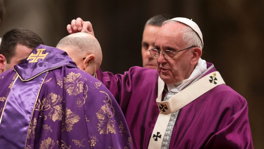 Feb. 10, 2016: Pope Francis places ashes on the head of Cardinal Tarcisio Bertone during the Ash Wednesday mass, in St. Peter's Basilica at the Vatican. (AP)
