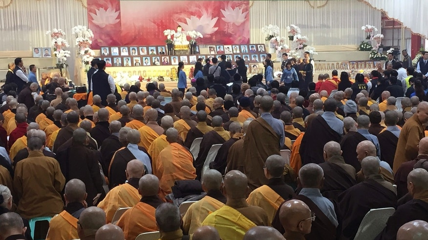Relatives, religious leaders and government officials at Friday's memorial in Tainan.