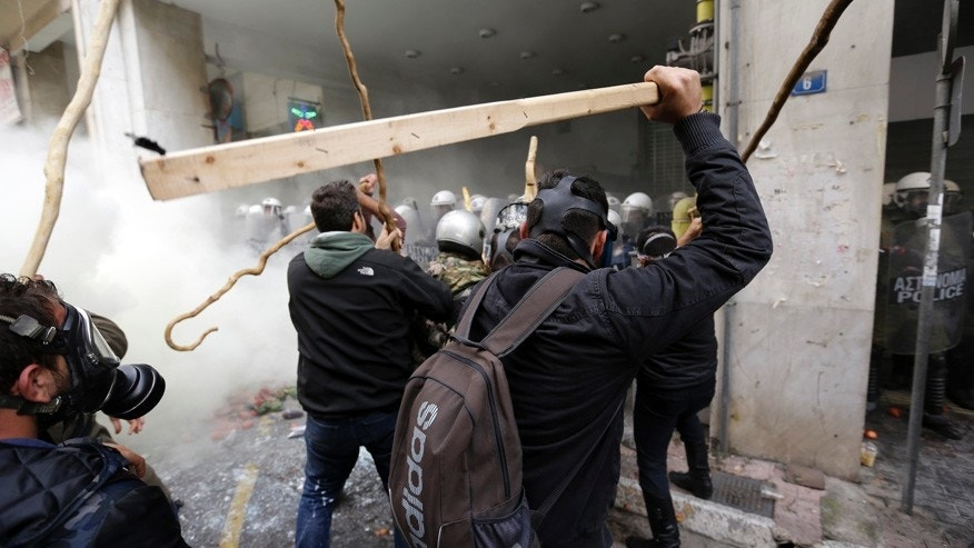 Feb. 12, 2016: Farmers clash with riot police during a protest outside Agriculture ministry in Athens.