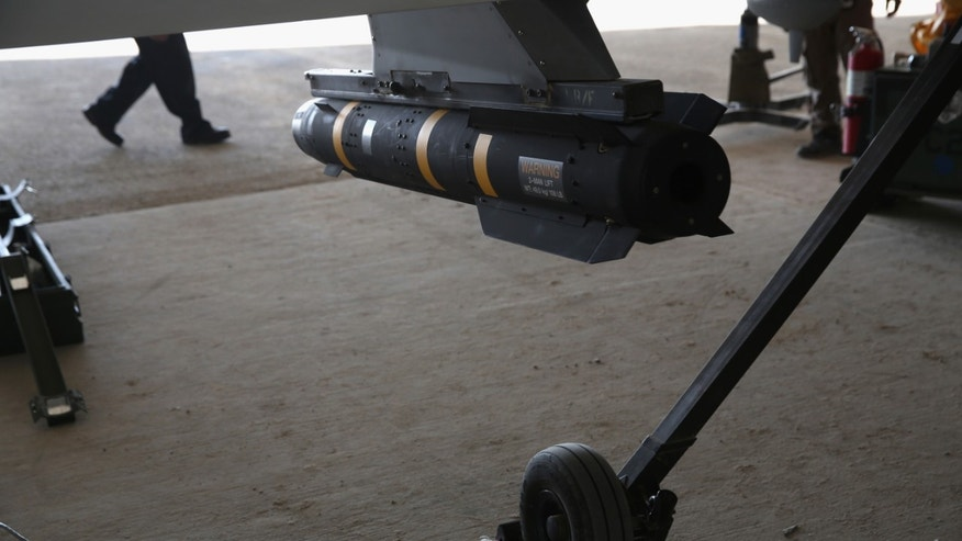 UNSPECIFIED, UNSPECIFIED - JANUARY 07:  A Hellfire missile hangs from a U.S. Air Force MQ-1B Predator unmanned aerial vehicle (UAV), at a secret air base in the Persian Gulf region on January 7, 2016. The U.S. military and coalition forces use the base, located in an undisclosed location, to launch drone airstrikes against ISIL in Iraq and Syria, as well as to transport cargo and troops supporting Operation Inherent Resolve. The Predators at the base are operated and maintained by the 46th Expeditionary Reconnaissance Squadron, currently attached to the 386th Air Expeditionary Wing.  (Photo by John Moore/Getty Images)