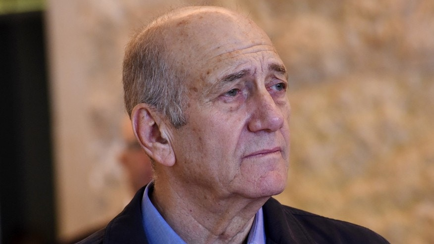 Dec. 29, 2015: Former Israeli Prime Minister Ehud Olmert leaves the courtroom of the Supreme Court after the court ruled on his appeal in the Holyland corruption case in Jerusalem.