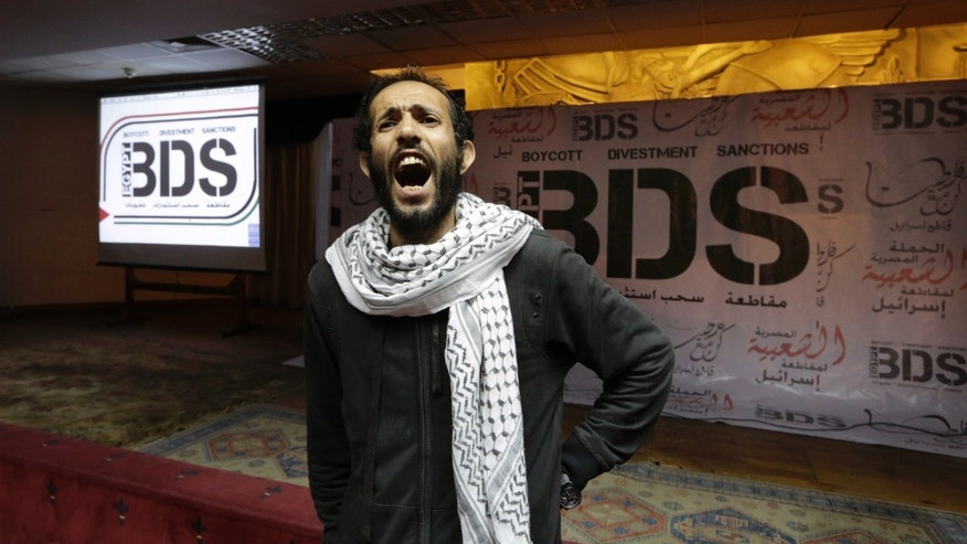 Apr. 20, 2015: Egyptian man shouts anti-Israeli slogans in front of banners with the Boycott, Divestment and Sanctions (BDS) logo during the launch of the Egyptian campaign that urges boycott, divestment and sanctions against Israel and Israeli-made goods. (AP)