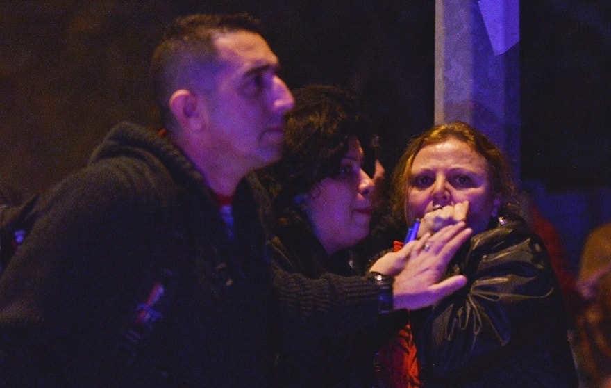 People react at the scene of an explosion in Ankara, Wednesday, Feb. 17, 2016. A large explosion, believed to have been caused by a bomb, injured several people in the Turkish capital on Wednesday, according to media reports. (IHA via AP) TURKEY OUT
