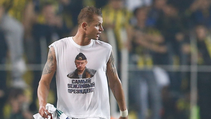 Feb. 16, 2016: Lokomotiv Moscow's Dmitri Tarasov wearing a t-shirt depicting Russian President Vladimir Putin. (Reuters)