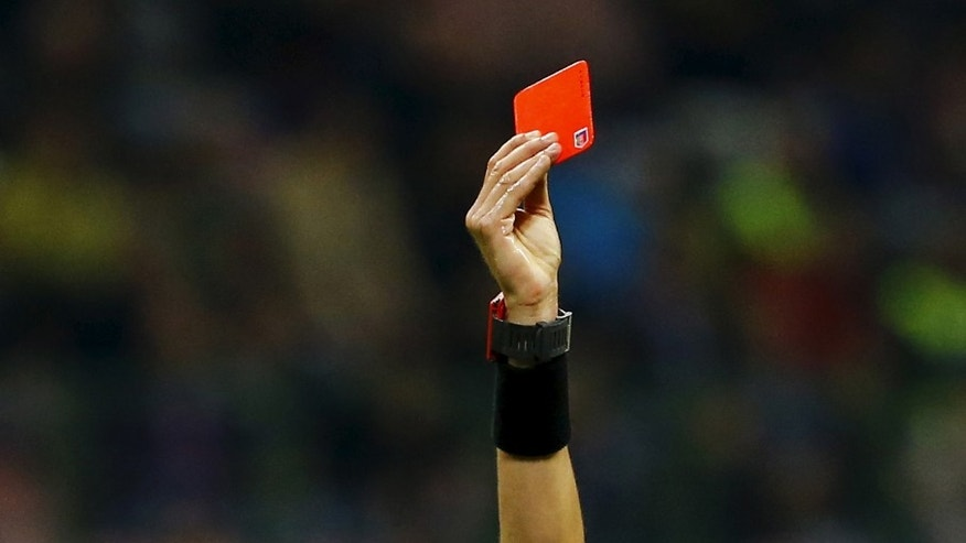 Referee shows a player a red card. (Reuters)