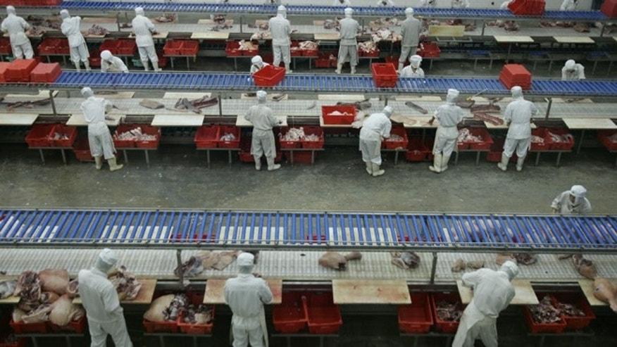 BEIJING, CHINA - SEPTEMBER 26: (CHINA OUT) Workers process pork at a slaughtering factory September 26, 2007 in Beijing, China. According to the State Food and Drug Administration (SFDA), China has strengthened the food inspection system and will launch a nationwide checkup on food safety, targeting food producers in its rural areas and urban-rural conjunctive regions, as a part of a four-month nationwide campaign to improve food safety in the country.  (Photo by China Photos/Getty Images)