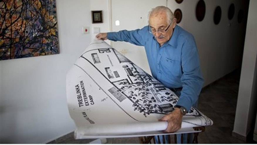 Holocaust survivor Samuel Willenberg displays a map of Treblinka extermination camp during an interview with the Associated Press at his house in Tel Aviv, Israel, Sunday, Oct. 31, 2010. (AP)